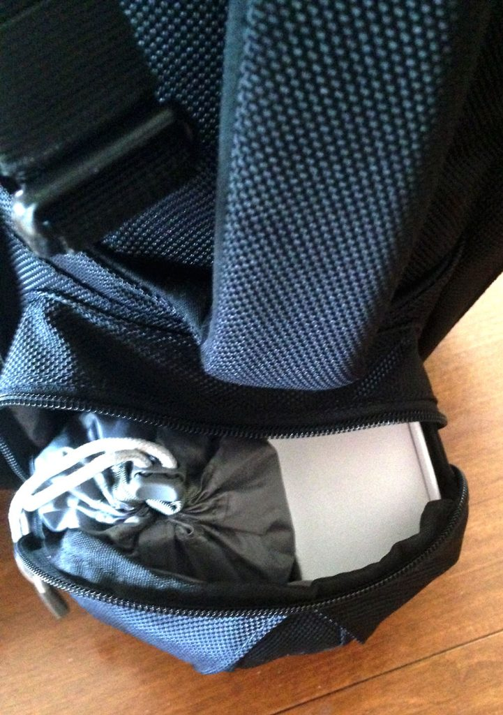 Raincover and Business cards stuffed into the other Tortuga side pocket