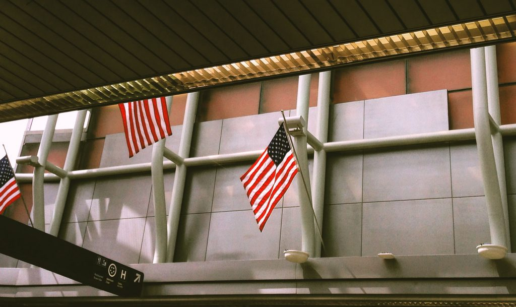 Flags adorn the American Airlines terminal at O'Hare International Airport